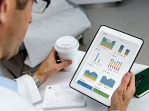 male doctor using McKesson Business Analytics on iPad